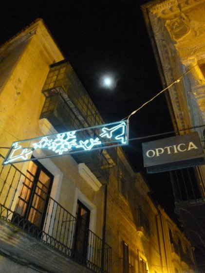 full of light, the moon, and some warm cafes